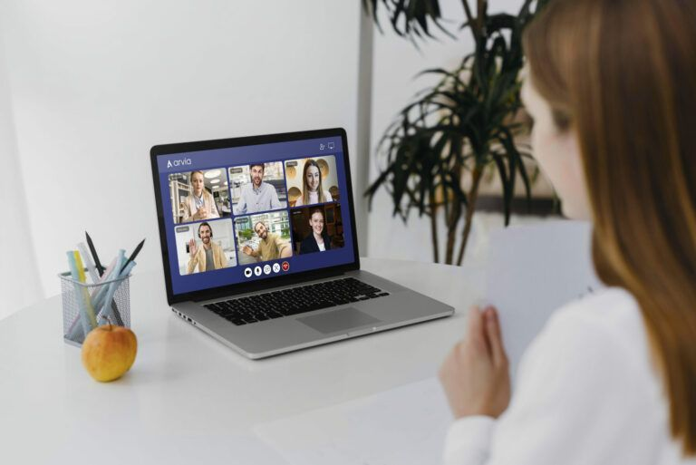A woman is attending an Arvia video chat with her computer