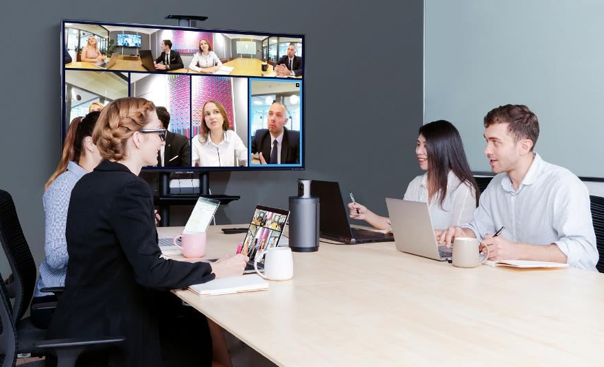Four people are in the video conferencing with some other people