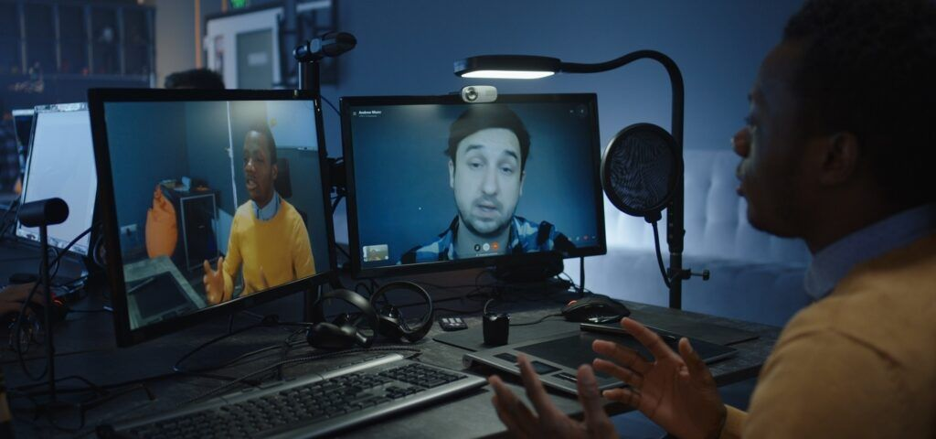 Two men are communicating via Arvia video chat