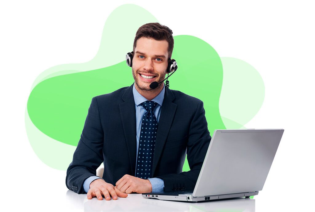 An assistant with a computer in front of green background